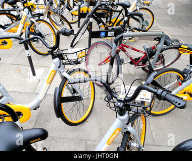 London.UK.15th July 2017.Singapore based oBikes start to appear on London streets in competition to Boris Bikes.© - Stock Photo