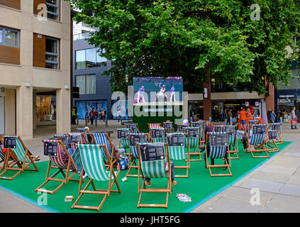 Bristol, UK. 15th July, 2017. Tennis fans watch coverage of the Wimbledon women's singles final on an open-air television - Stock Photo