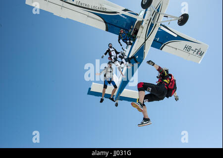 Skydivers Skydivers exiting a Pilatus Porter for a fun jump - Stock Photo