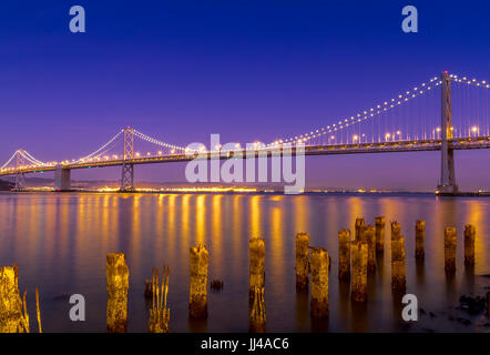 Spanning the Cities Of Oakland and San Francisco,the magnificent  Oakland Bay Bridge At dusk ,From The Embarcadero - Stock Photo