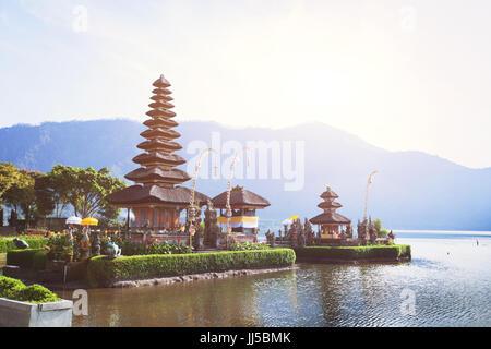 holy temple Pura Ulun Danu Bratan on the lake in Bali, Indonesia - Stock Photo