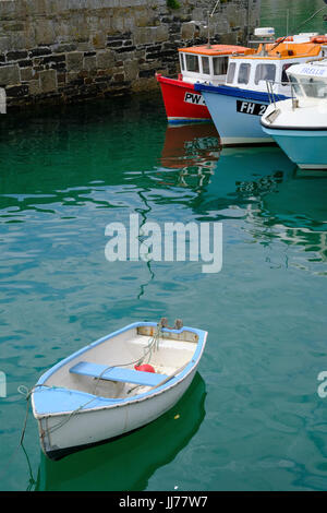 Rowing boats in Newquay Harbour - Stock Photo