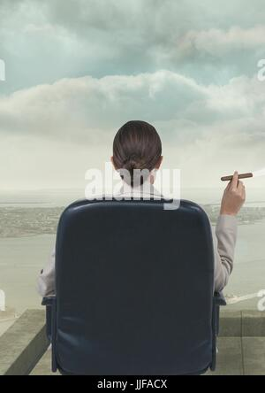 Digital composite of Rear view of businesswoman sitting in chair smoking cigarette against sky - Stock Photo