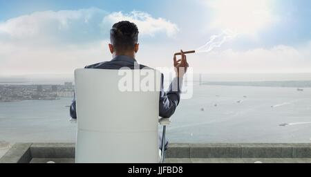 Digital composite of Rear view of businessman sitting on chair and smoking cigar while looking at sea against sky - Stock Photo