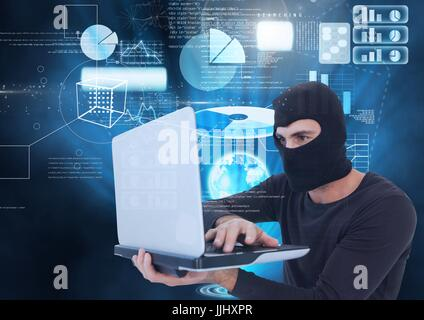 Digital composite of Hacker using a laptop in front of digital background - Stock Photo