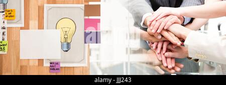 Business team putting hands together and sticky notes transition - Stock Photo