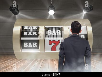Back of Man Looking at 3d casino slot machine - Stock Photo