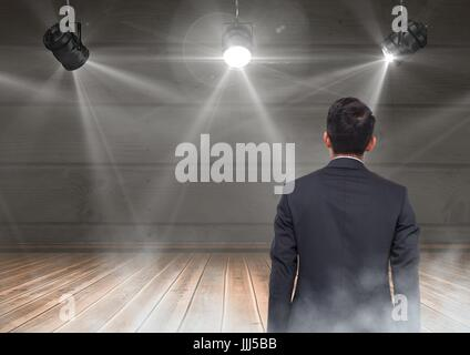 Back of Man Looking at stage lights - Stock Photo