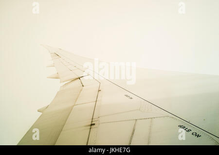 View from Plane on in-flight Transalantic Passanger Airplane, Airplane Wing - Stock Photo