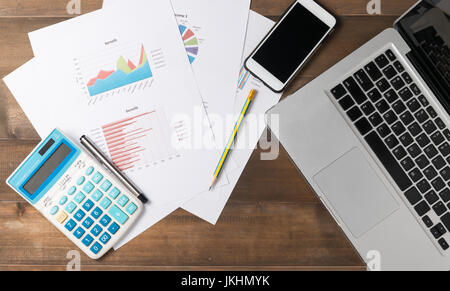 business accessories (notebook, calculator, planchette, tablet, pencil, pen, smartphone) and graphics, tables, charts - Stock Photo