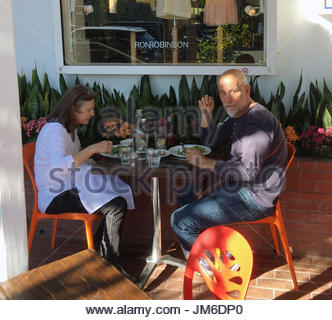 John Malkovich,Nicoletta Peyran.John Malkovich and wife Nicoletta Peyran at lunch outside Fred Segal in West Hollywood. - Stock Photo