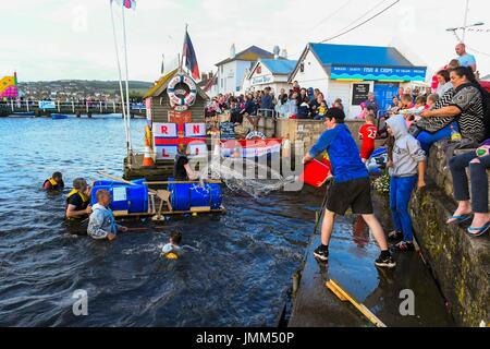 West Bay, Dorset, UK.  27th July 2017.  Annual RNLI Raft Race on the River Brit at the seaside resort of  West Bay - Stock Photo