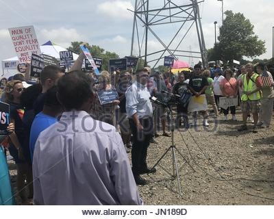 New York, USA. 28th July, 2017. A protester speaks outside Sufflock County Community College in Long Island on July - Stock Photo