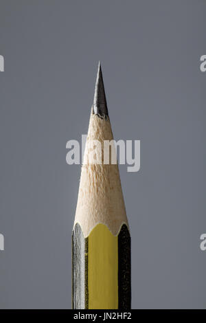 Close Up of a Pencil Tip on Gray Background - Stock Photo