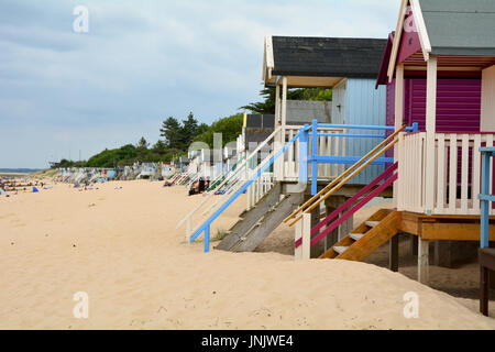 Brightly painted wooden beach huts at Wells-next-the-sea in Norfolk England - Stock Photo
