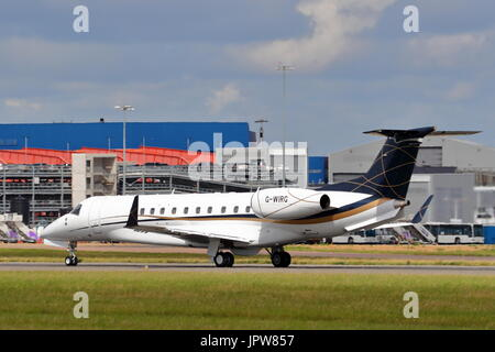Embraer ERJ-135 Legacy G-WIRG business jet taking off at London Luton Airport, UK - Stock Photo