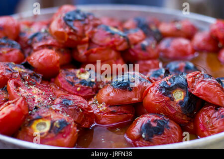 Red tomatoes baked on the grill - Stock Photo