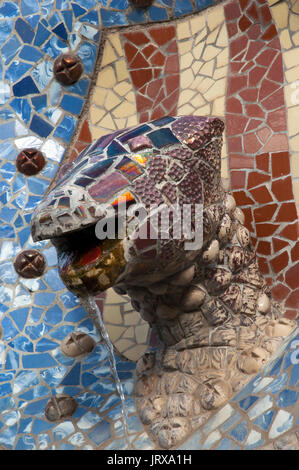 detail of trencadis work lizard head water spout in parc guell Barcelona spain - Stock Photo