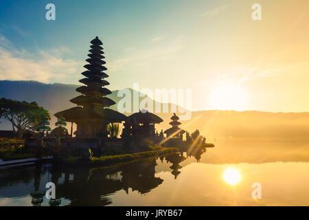 A beautiful sunrise at a Lake Bratan with UlunDanu temple / Pura Ulun Danu Bratan, Hindu temple on Bratan lake landscape, - Stock Photo