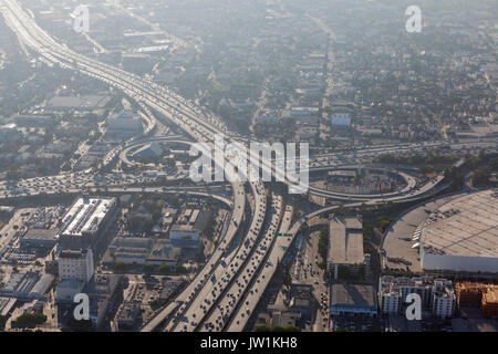 Smoggy afternoon aerial view of Harbor 110 and Santa Monica 10 freeways in downtown Los Angeles, California. - Stock Photo