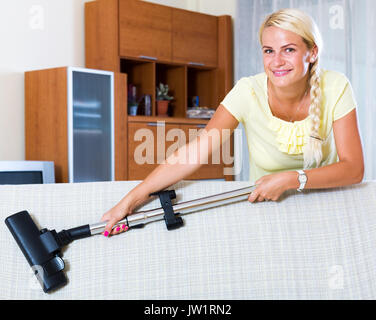 Happy Adult Blonde Girl Hoovering In Living Room And Smiling Stock Photo Royalty Free Image