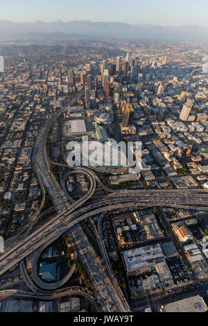 Los Angeles, California, USA - August 7, 2017:  Smoggy afternoon aerial view of downtown Los Angeles freeways in - Stock Photo