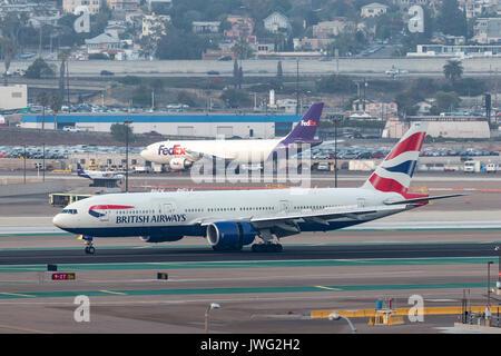 British Airways Boeing 777-236/ER G-YMMU arriving at San Diego International Airport. - Stock Photo