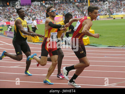 London, UK. 12th Aug, 2017. Spain's Oscar Husillos (C) and Lucas Bua (R) compete in the men's 4x100m Relay heats - Stock Photo