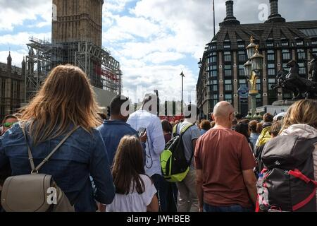 London, UK 12th August 2017. Crowds of tourists on Westminster Bridge on a overcast but warm day with tempertures - Stock Photo