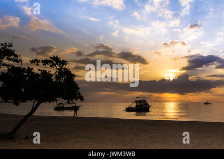 Sunset on the Beach at Negril, Jamaica - Stock Photo