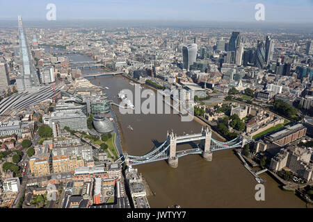 aerial view of Tower Bridge, Shard, Thames, & City of London skyline - Stock Photo