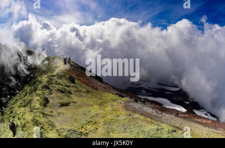 Kamchatka Territory, Russia. 12th Aug, 2017. Clouds over the crater of Avachinsky active stratovolcano. Credit: - Stock Photo