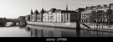 Black & White morning view of the Conciergerie on Ile de la Cite and the Seine River, Paris, 1st Arrondissement. - Stock Photo