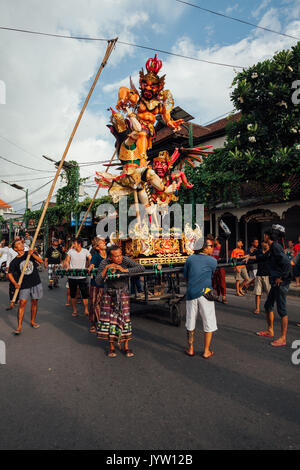 Bali, Indonesia - March 08, 2016:   Ogoh-Ogoh statues are transported to the parade during Balinese New Year celebrations - Stock Photo