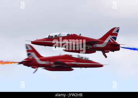 Royal Air Force Red Arrows opposition pass near miss at Biggin Hill Festival of Flight airshow. Space for copy - Stock Photo