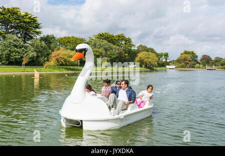Mewsbrook Park, Littlehampton, West Sussex, England, UK. Sunday 20th August 2017. UK Weather. A family enjoy riding - Stock Photo