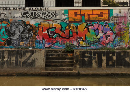 the wall completly covered by bright street graffities in Bangkok, Thailand - Stock Photo