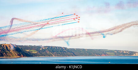 The Royal Air Force Red Arrows team perform in their BAE Hawk aircraft at their display in Sidmouth, England - Stock Photo