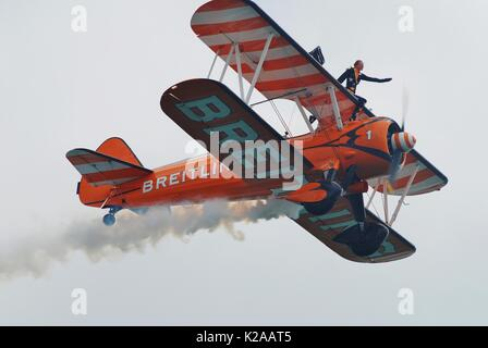 The Breitling Wing Walking display team perform at the Airbourne airshow at Eastbourne in East Sussex, England on - Stock Photo