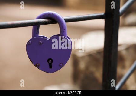 Aged padlock. Love heart shape design, violet paint metal texture, pattern and vintage design. love sign and romance - Stock Photo
