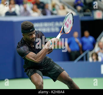 New York, Ny Usa. 29th Aug, 2017. Frances Tiafoe of USA returns ball during match against Roger Federer of Switzerland - Stock Photo