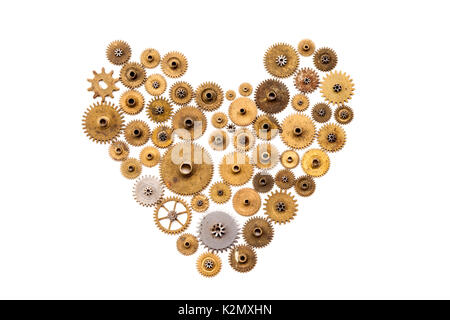 Heart steampunk ornament style on white background. Vintage clockwork parts closeup. Abstract mechanical shape with - Stock Photo