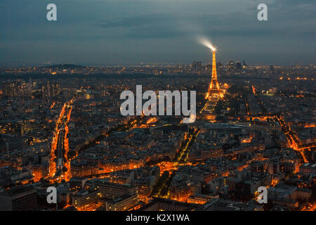 Paris with Eiffel tower as it's most important landmark in the city. View from the Montparnasse panorama tower. - Stock Photo