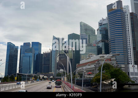 Skyline of Singapore with highway in the foreground - Stock Photo