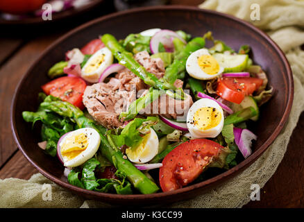 Salad with tuna, tomatoes, asparagus and onion. Salad Nicoise - Stock Photo