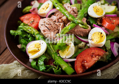 Salad with tuna, tomatoes, asparagus and onion. Salad Nicoise - Stock Photo