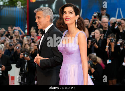 Venice, Italy. 02nd Sep, 2017. George Clooney and Amal Clooney attend the premiere of 'Suburbicon' during the 74th - Stock Photo