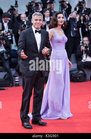 Venice, Italy. 2nd Sep, 2017. Director George Clooney (L) and his wife Amal attend the premiere of the movie 'Suburbicon' - Stock Photo