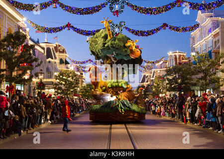 Disney's Christmas parade 'The lion king' at Disneyland Paris Marne La Vallee France - Stock Photo