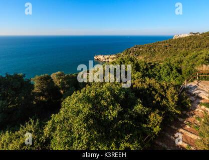 Summer sea perched Peschici town and cape Trabucco di Monte Pucci view, Gargano peninsula in Puglia, Italy - Stock Photo